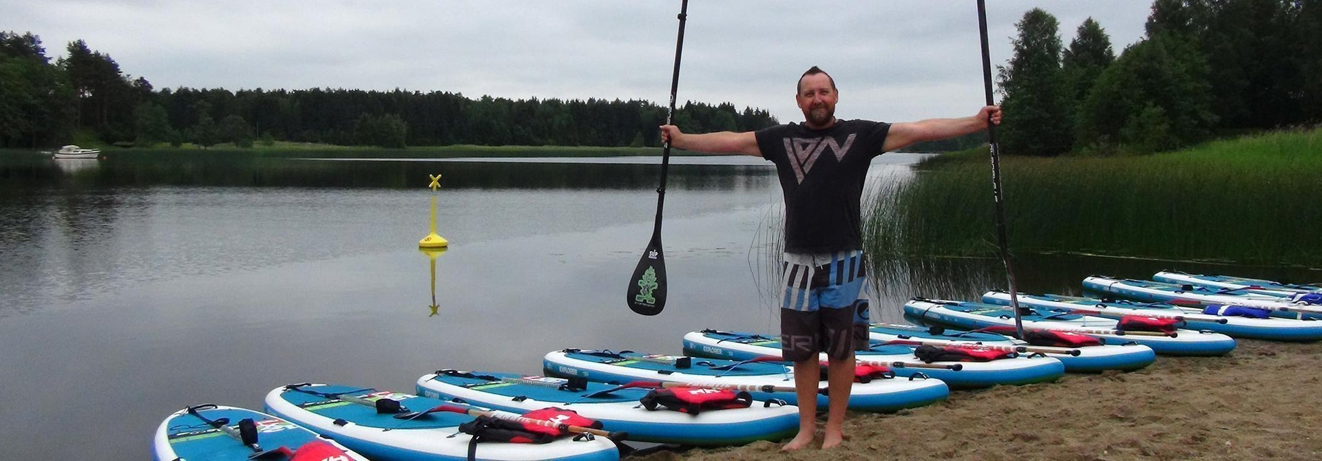 SUP Norway - Stand up paddling - Titus awaiting a class to arrive. Vannsjø